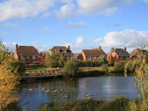 Elvetham Heath houses overlooking pond